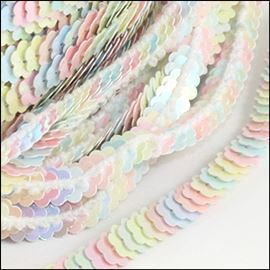 Strung Elasticated Daisy Sequins.  6mm. Candy.